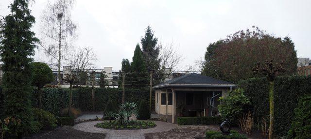 Tuinaanleg met tuinhuis en veranda